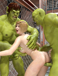 Green-skinned alien fighters double-team a sexy referee